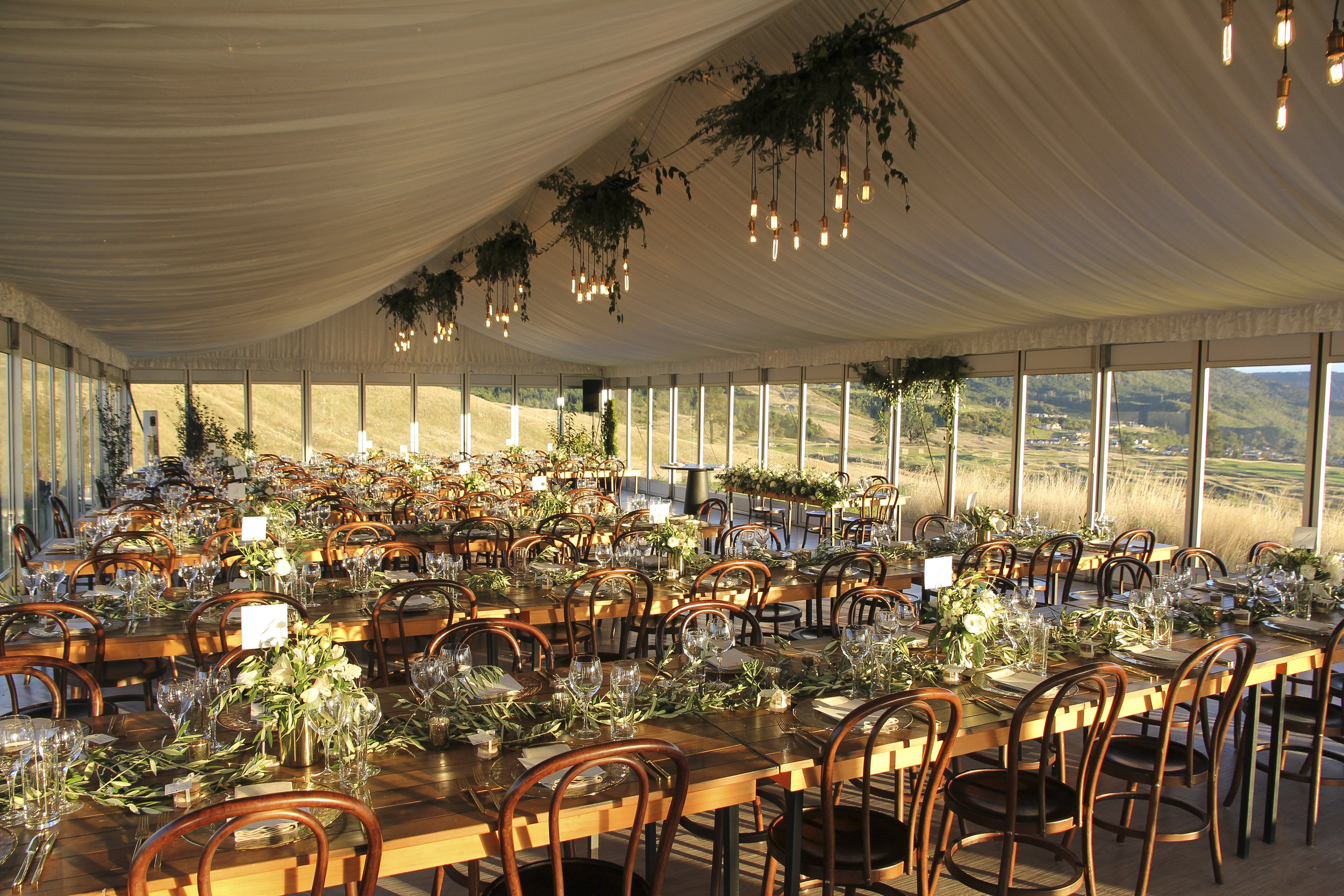 vintage bulb chandeliers with greenery