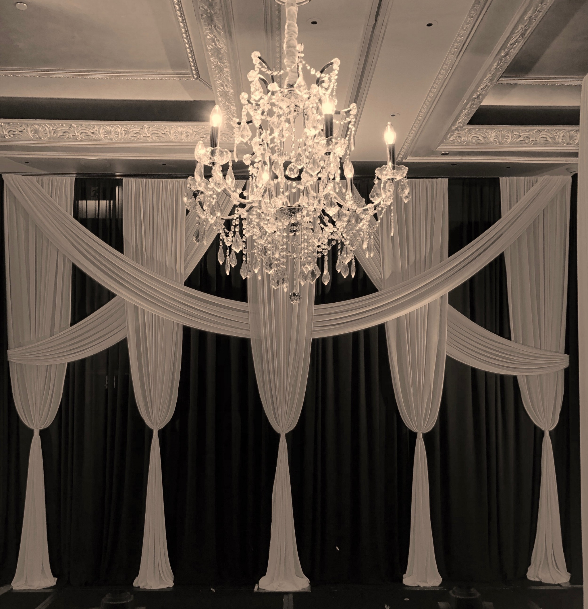 black and white backdrop and chandelier