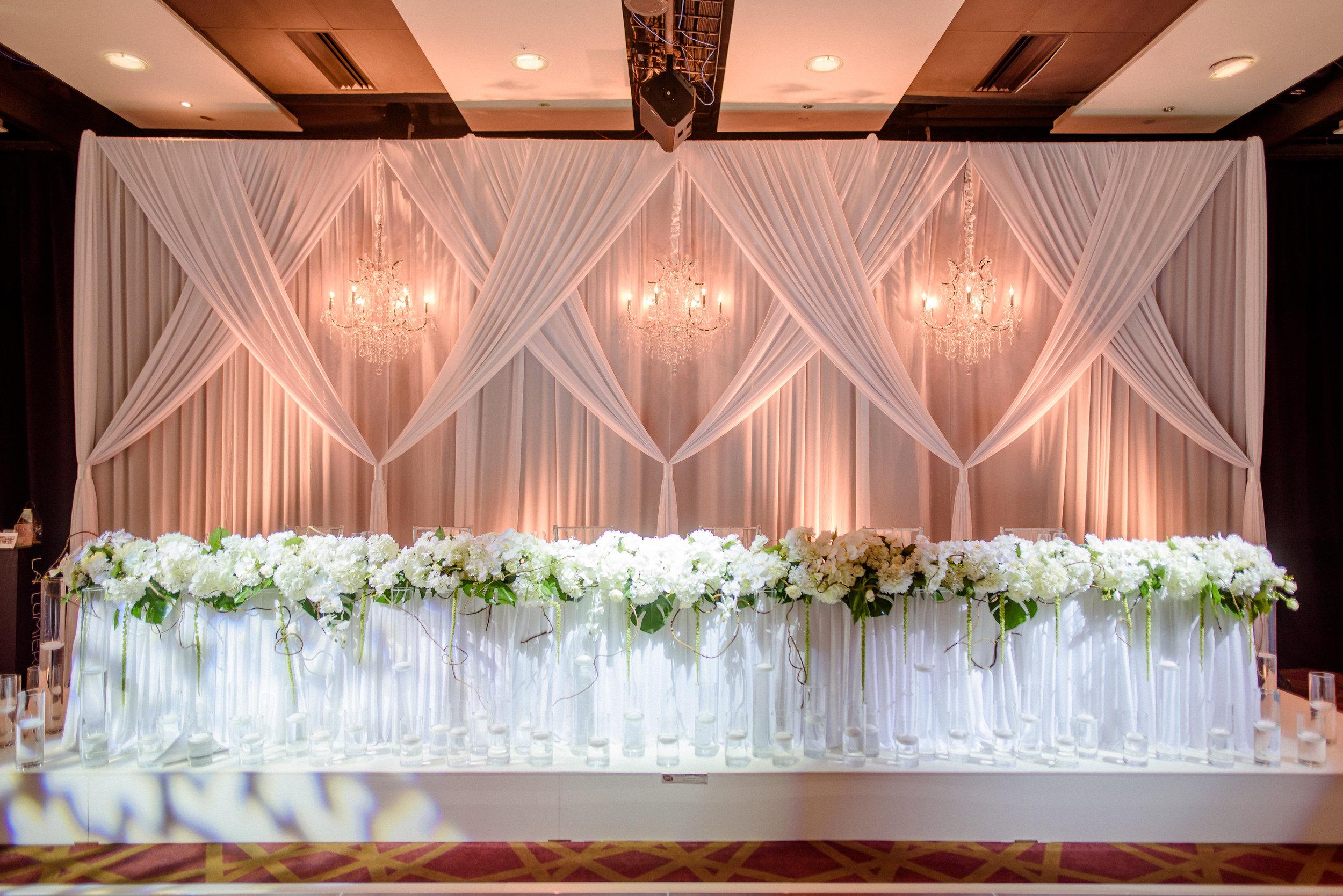 bespoke draped backdrop with chandeliers