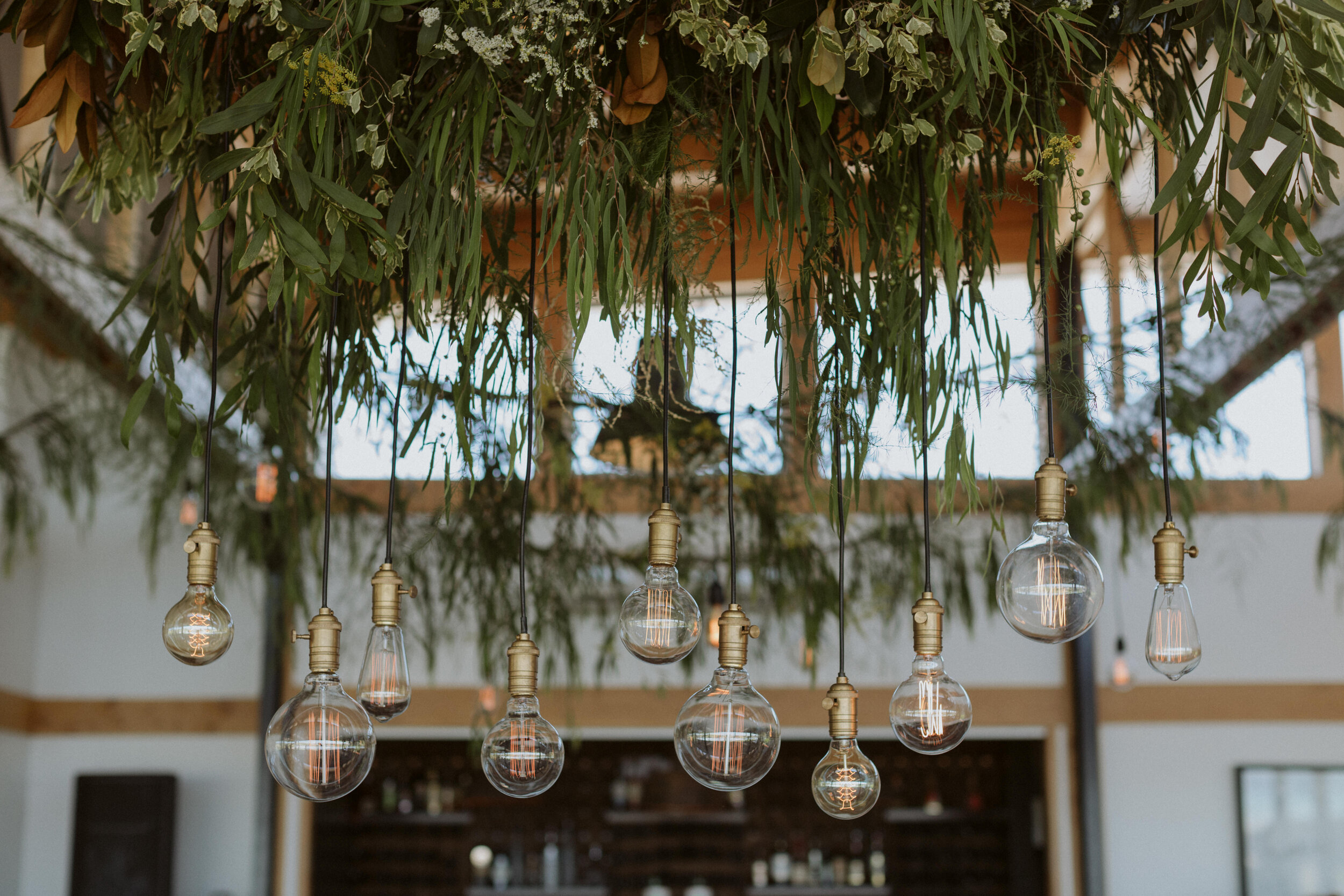 vintage bulb chandelier with greenery