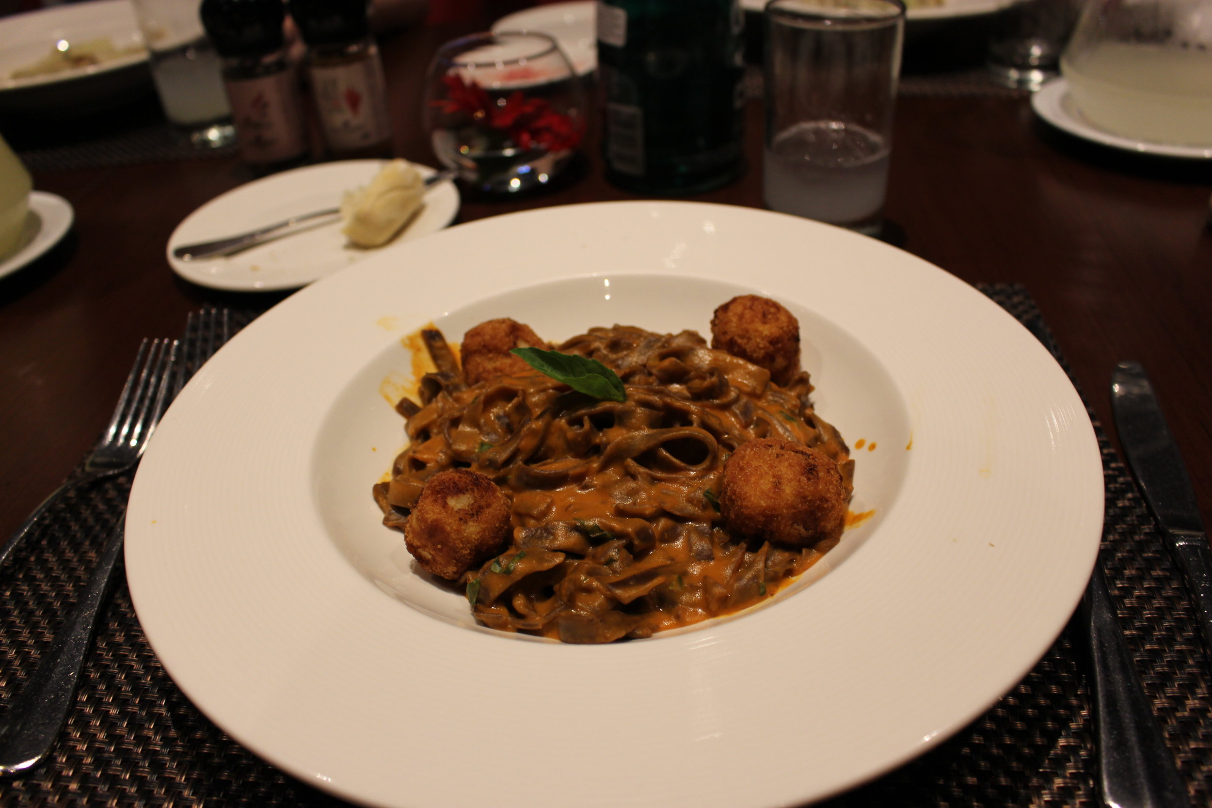 This was my meal. Not sure what I ordered exactly, but it was a savory cream pasta with quinoa chicken meatballs. Very delicious.  Restaurant: Costa del Sol Wyndham Restaurant