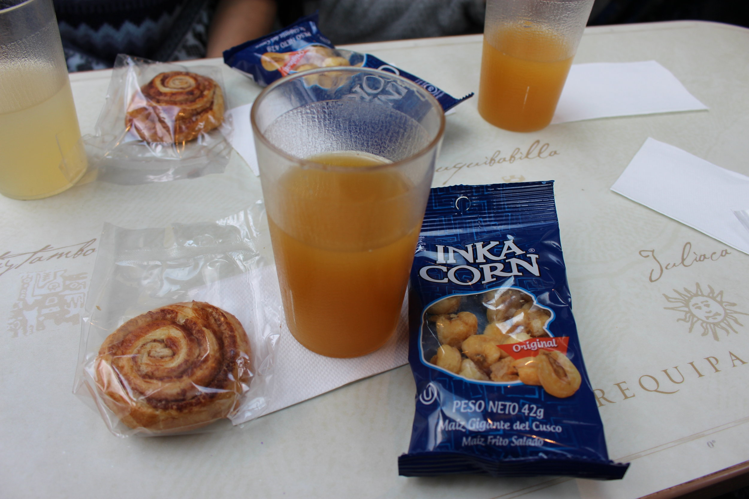 Later that afternoon we went on the train again to go back to Ollantaytambo. This time they served up cinnamon buns and a typical snack, Inca Corn. The cinnamon bun was very good, but I wanted to save the Inca Corn for when I got back to the U.S. I still haven't tried it.  Restaurant: PeruRail Train