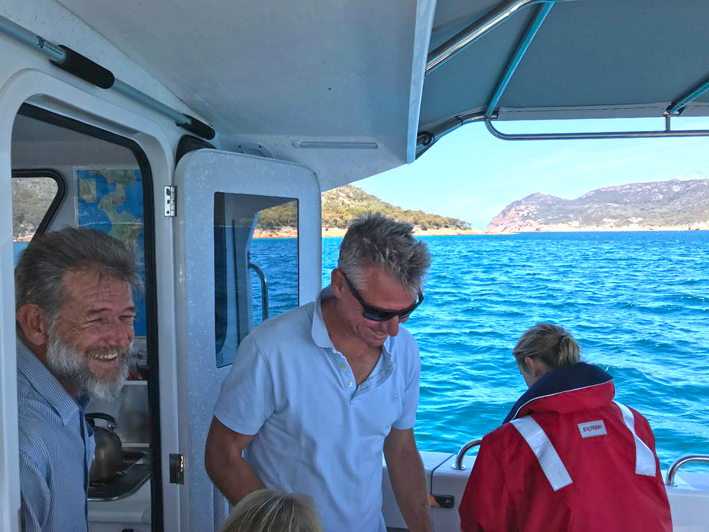 Your Skipper Stephen on the left, onboard with guests. Photo courtesy of Stuart Walker.