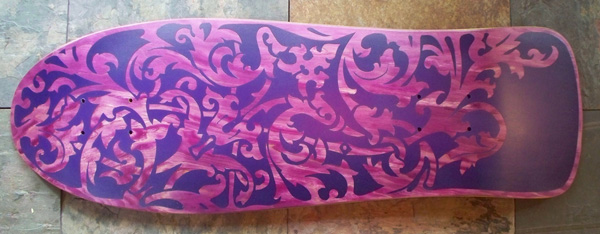 Customize a skateboard with tape stencil
