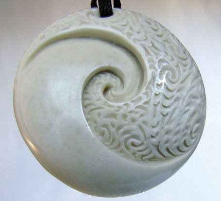 In this double spiral carving, the two ira are expressed as the plain and the textured elements