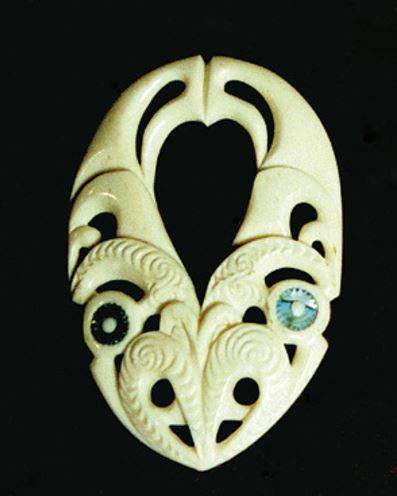 Bone carving representing ika, the fish