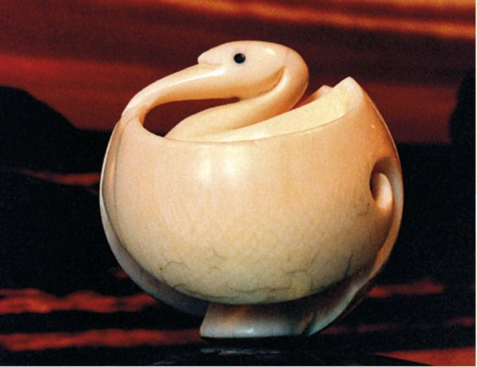This kōtuku was commissioned by Toyota NZ as a gift to their parent company in Japan to mark New Zealand's sesquicentennial year. The kōtuku was chosen as white herons or white cranes are sacred birds in both countries. I have an interest in the fascinating Japanese tradition of netsuke carving and decided to do it in the netsuke form, but using a Máori style of carving to add a further cultural link.