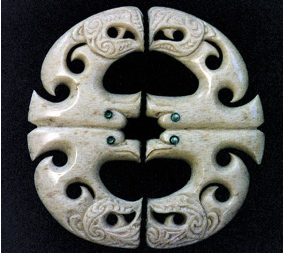 Kahu circling overhead, carved from sperm whale jawbon