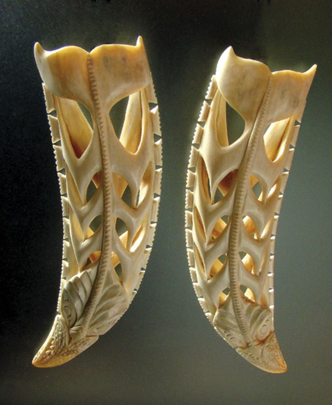 A pair of whale figures carved from a tooth of the whale called Hoon