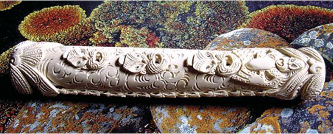 A koauau carved from ostrich bone