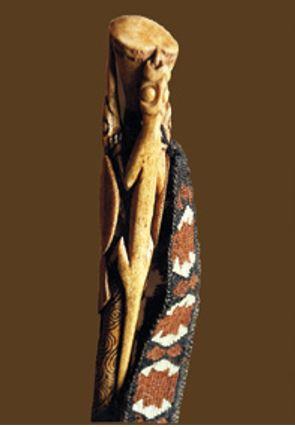 A weaving peg holding a muka belt made by Te Aue Davis