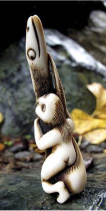 Aroha Hinapóuri, an antler carving by Doug Marsden depicting Hine te Repo and Tunaroa