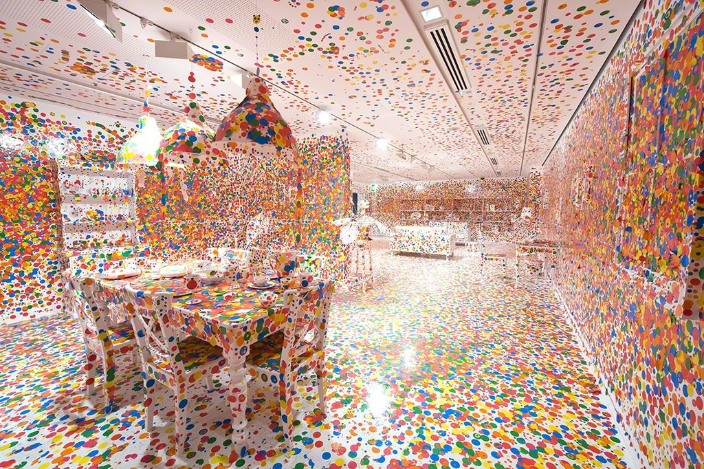 The Obliteration Room - 2002-Present | Furniture, white paint, and dot stickers.