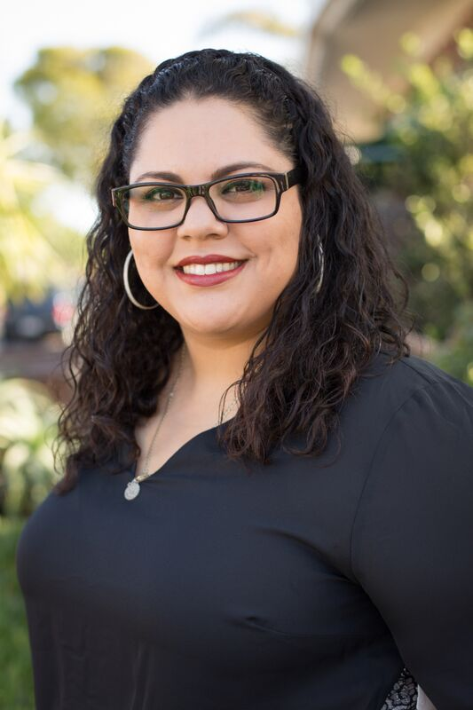 """Speaking about what she finds rewarding about her work as a paralegal for a personal injury law firm, Yolanda says, """"We deal with people who are injured at no fault of their own. Knowing that I can help, even if all I do is lend an ear, that gives me satisfaction."""" Photo by Marcy Browe Photography"""