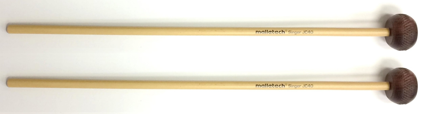 """The Malletech Go2 Series presents the Jon Singer Rosewood Xylophone Mallet. Jon has used wooden mallets on his xylophone for many years and found that he liked the heads best after the fibers started to break down. Malletech has found a way to """"pre-stress"""" the surface to get to that perfect, slightly softer attack right out of the bag.  Unlike many """"rosewood"""" mallets that are really other species of wood, these are made from marimba bars that didn't make the grade in Malletech's instrument department.  1-1/4-inch diameter certified Dalbergia Stevensoni Honduran Rosewood heads  7.5 to 8 mm diameter rattan  Available from Steve Weiss Music at:   https://www.steveweissmusic.com/product/malletech-go2-series-js40-jon-singer-custom-rosewood-xylophone-mallets/malletech-mallets#full-description"""