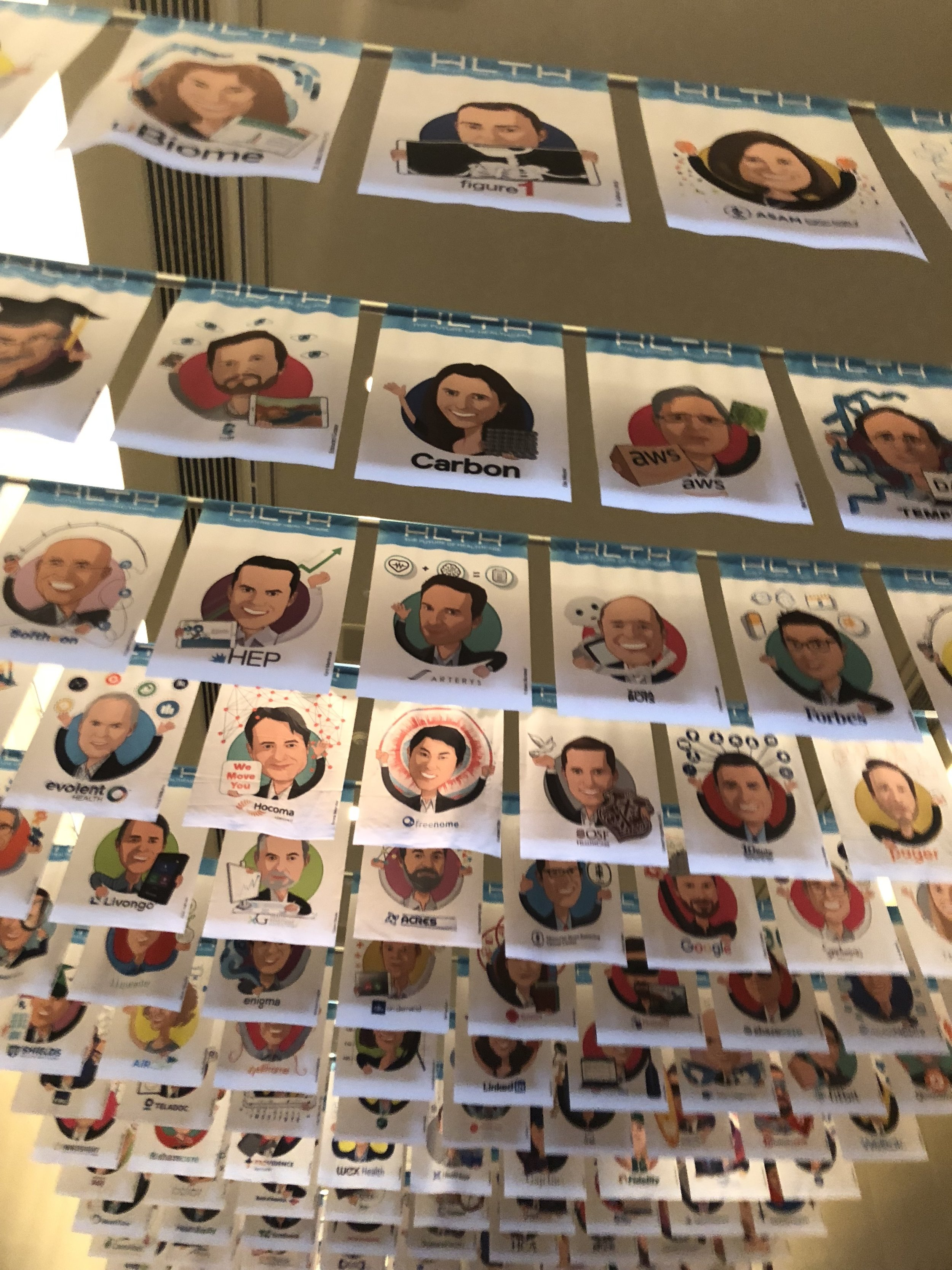 HLTH2018 General Session Hall carefully watched from above by speaker & sponsor avatars