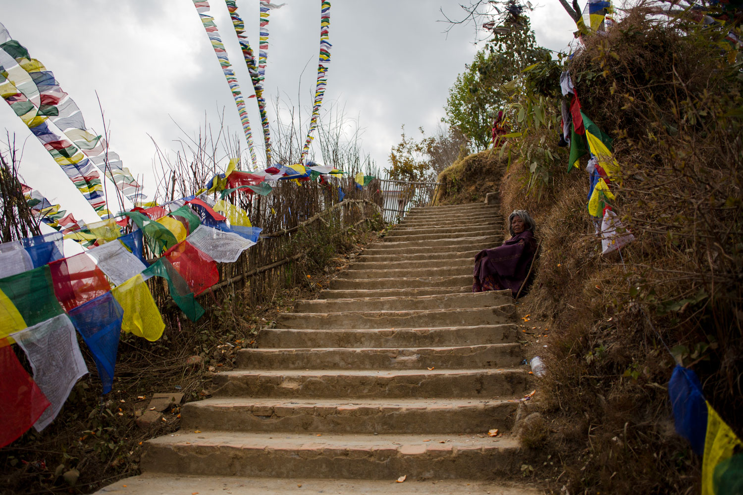 Woman-sitting-on-stairs-at-temple-in-nepal.jpg
