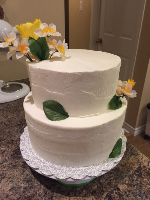 Simple yellow floral wedding cake