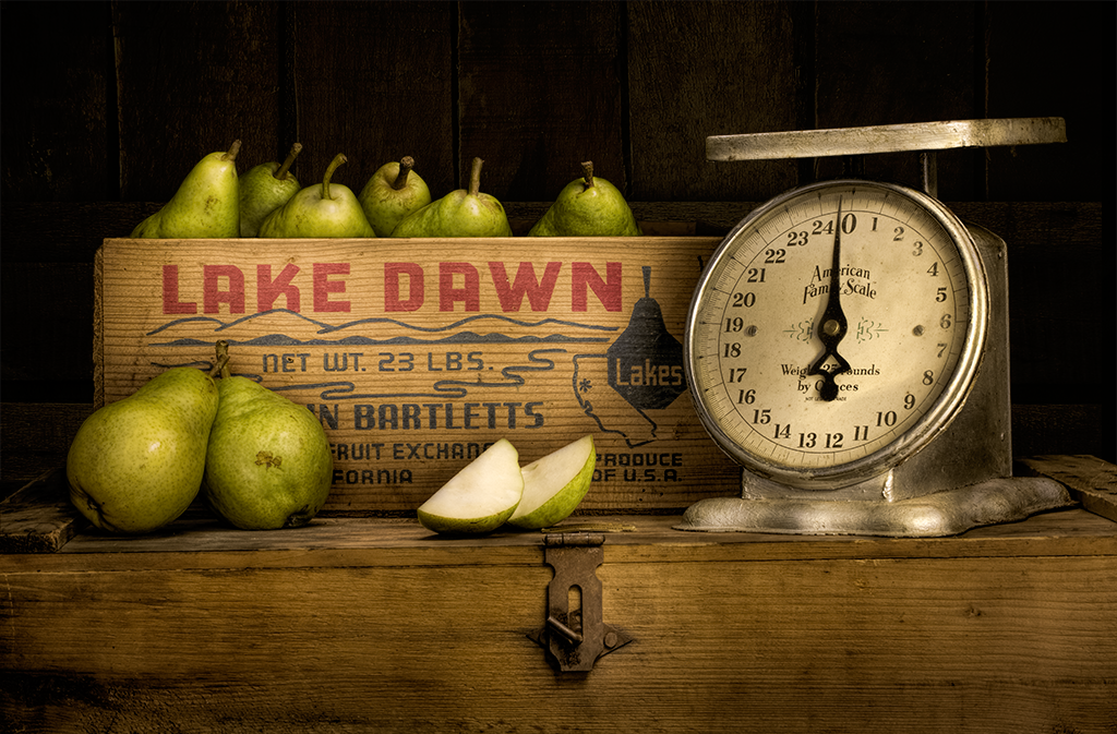 Still life of pears and antique scale.