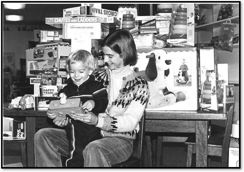 Deb with her second child, Ben, at the original Toy Library in Rochester NY, 1985.