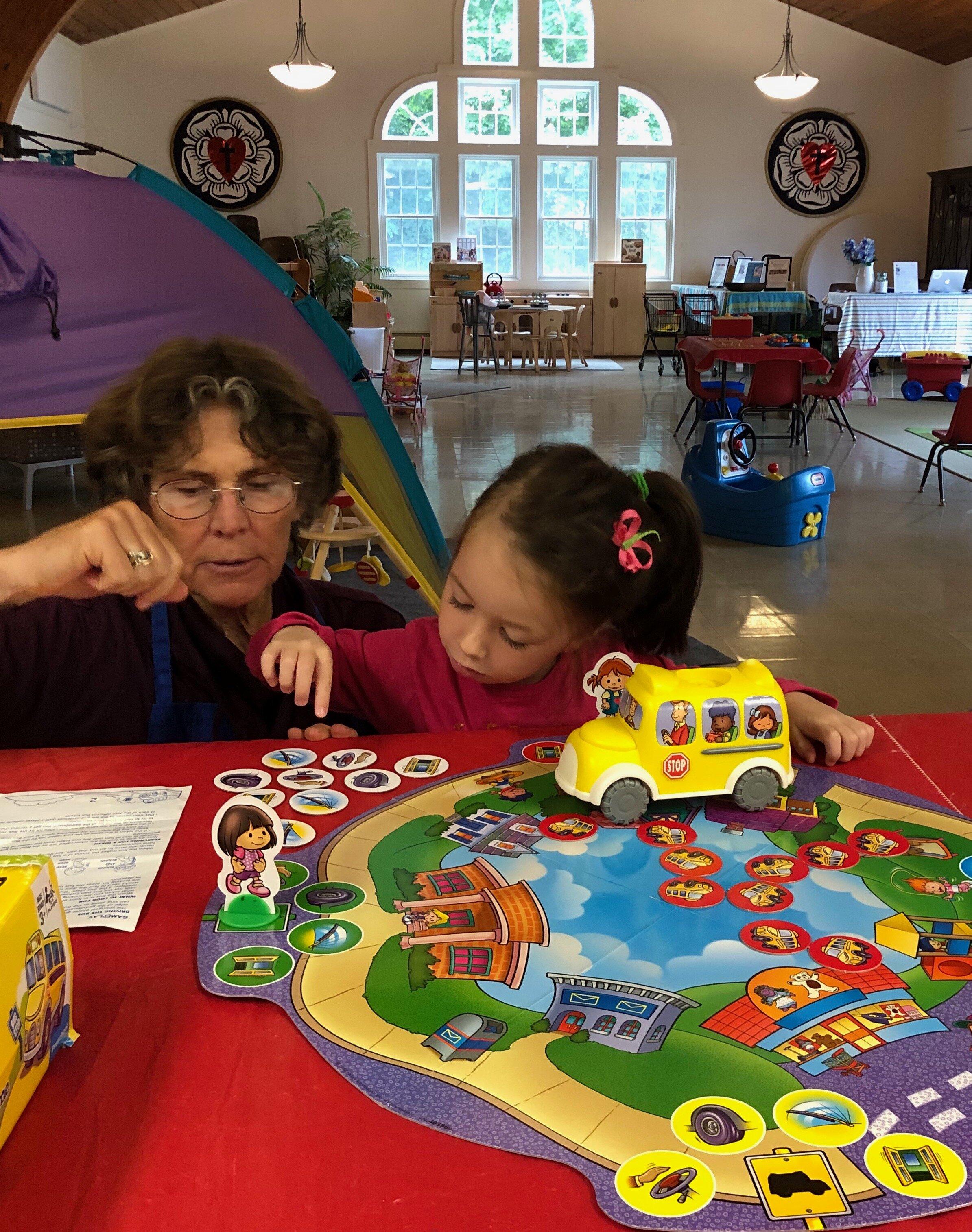 photo Bonny & child with School bus game.jpg