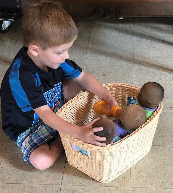 boy feeding doll.jpg