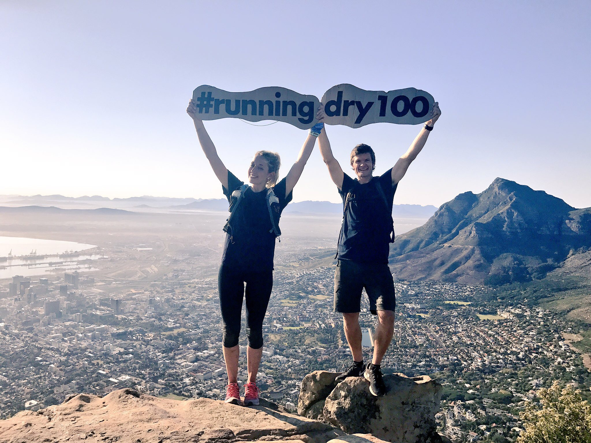 Finishing our 100km run, 24 hours after we started on top of Lion's Head.
