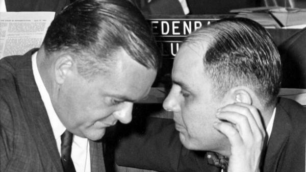 The Sunshine Law does not apply to the Florida Legislature or the courts. In this 1963 photo, Florida State Rep. Ralph D. Turlington, of Alachua County, whispers with Rep. John J. Crews, of Baker County. Generally, this sort of communication outside of the public's view by city or county elected officials would be disallowed under the Sunshine Law.