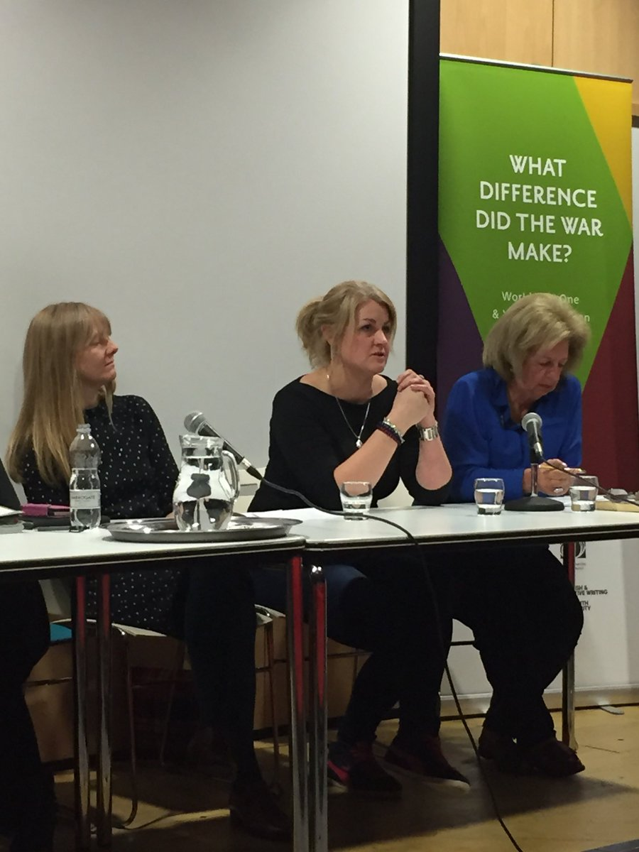 Me on a panel looking serious.