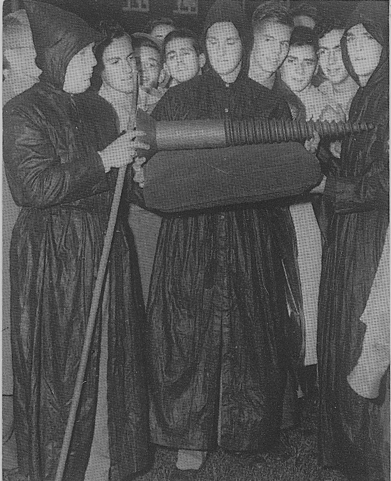 """Brother Arnold Zimmer '50 (center) escorted by SigEp """"Tibetan Monks"""" Bill Krucke '51 and Fred Lane '51 present The Screw in 1948."""