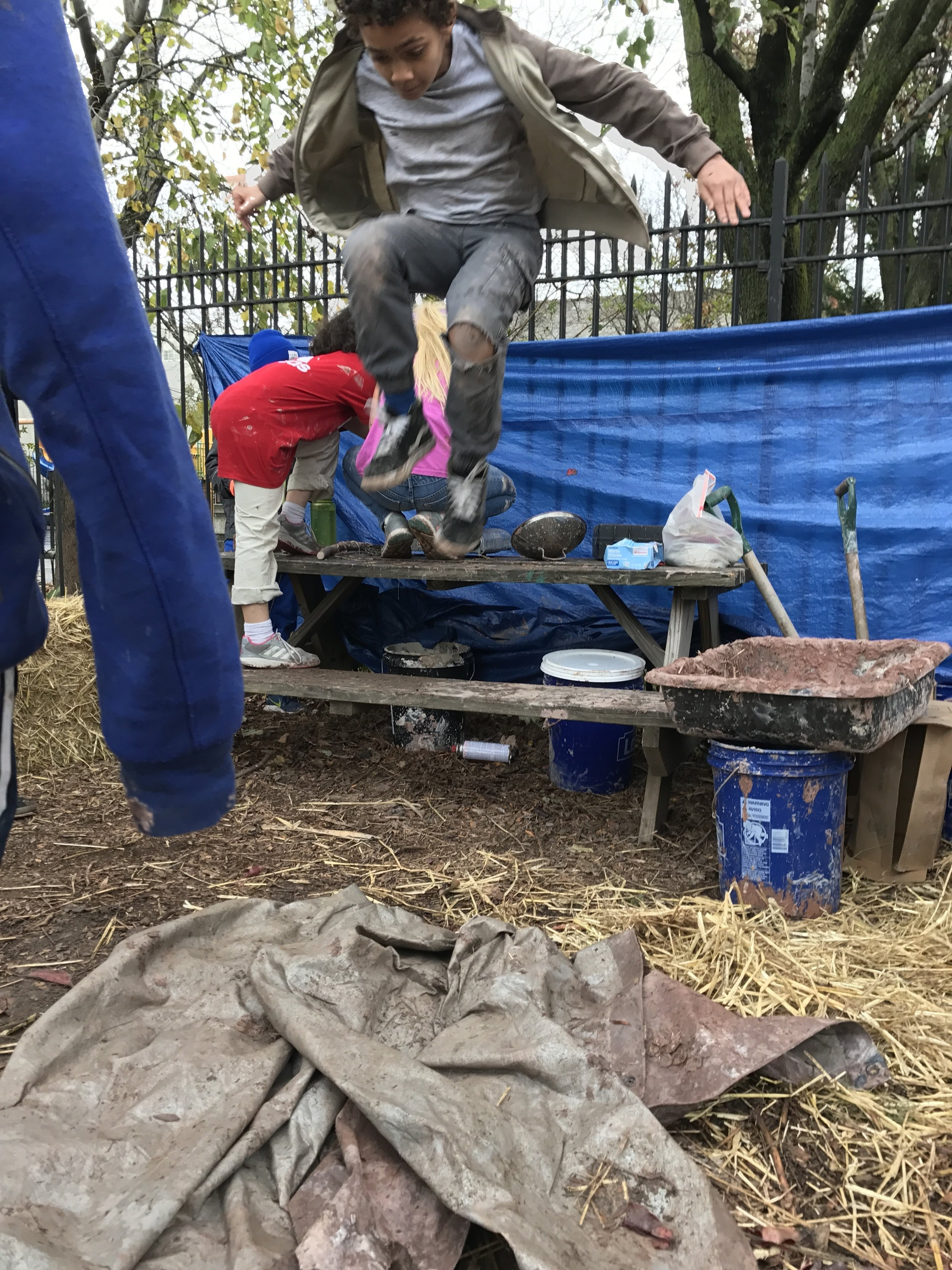 Processing the daub: mixing clay, sand and hay