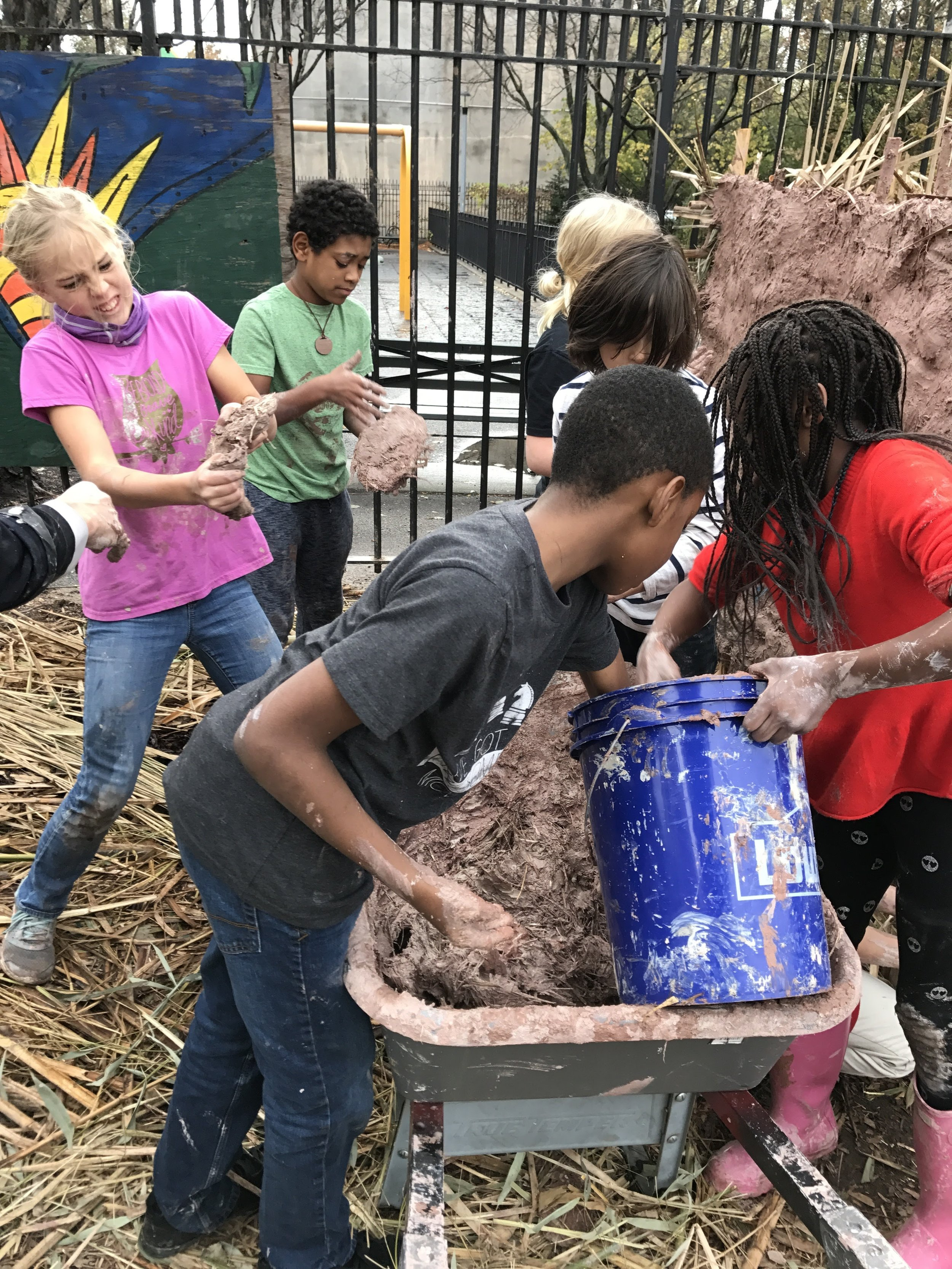 Mixing the clay, straw and sand