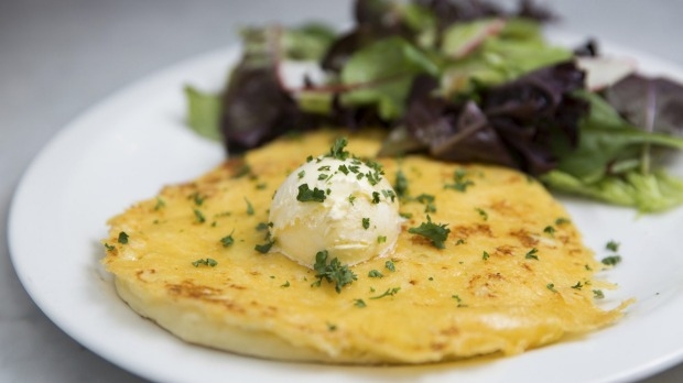 Cheese and potato pancake topped with whipped butter. Photo: Paul Jeffers