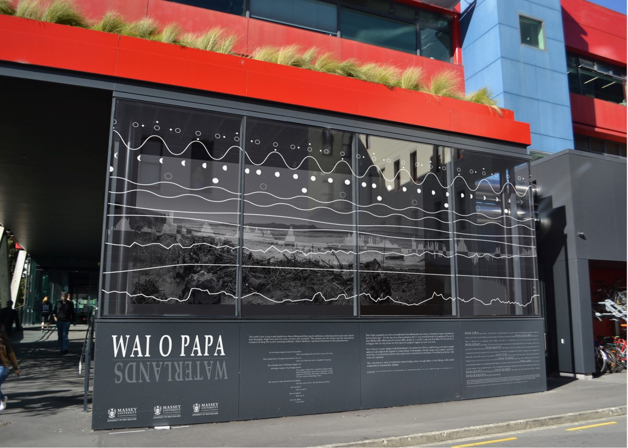 Exhibition at the School of Architecture, Victoria University of Wellington, showing graph cycles on window and image of river mouth by Martin Manning behind, 2016.