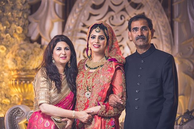 Just #love this #photo  As #photographers we often have to #pose people in #portraits but @mahiya.si and her #lovley #parents just #naturally had a #link #between them. #family #connection #bond #linking #red #gold #jewelry #familygoals #daddysgirl #motherdaughter #asianwedding #opusultanphotography #osp #bridal #bridalinspiration