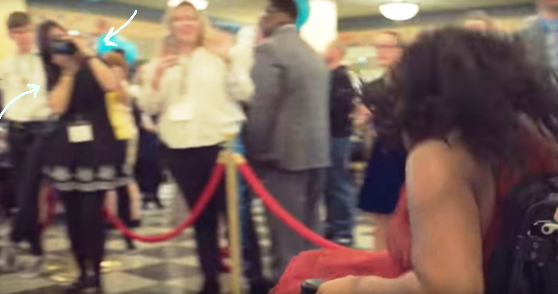 (I spotted a quick shot of me taking paparazzi pictures on the red carpet 1:23 minutes in to the video!)