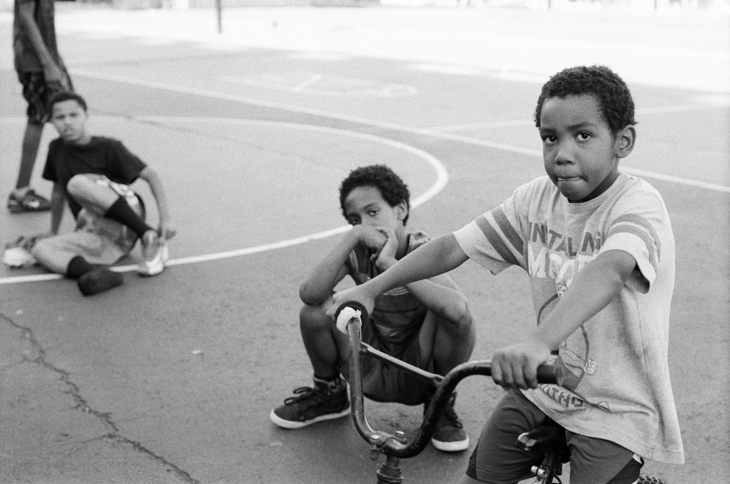 Boys on a playground.   Staten Island, New York City. 2018.