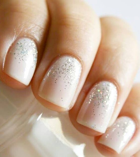 Frosting - Ask for 'Squared' using Essie 'Baby's Breath' and a silver glitter at the nail base