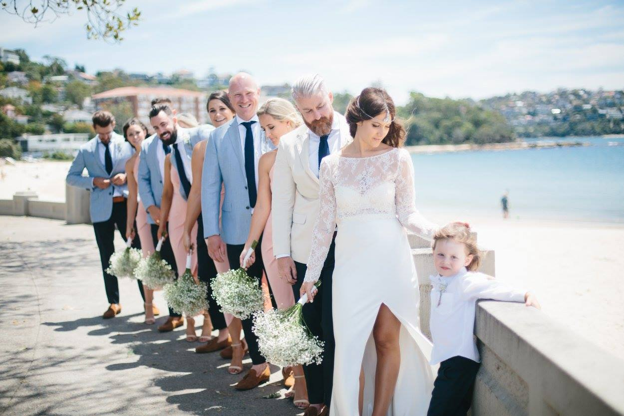 Lizzy, Mitch, Flynn and the whole gang on their wedding day