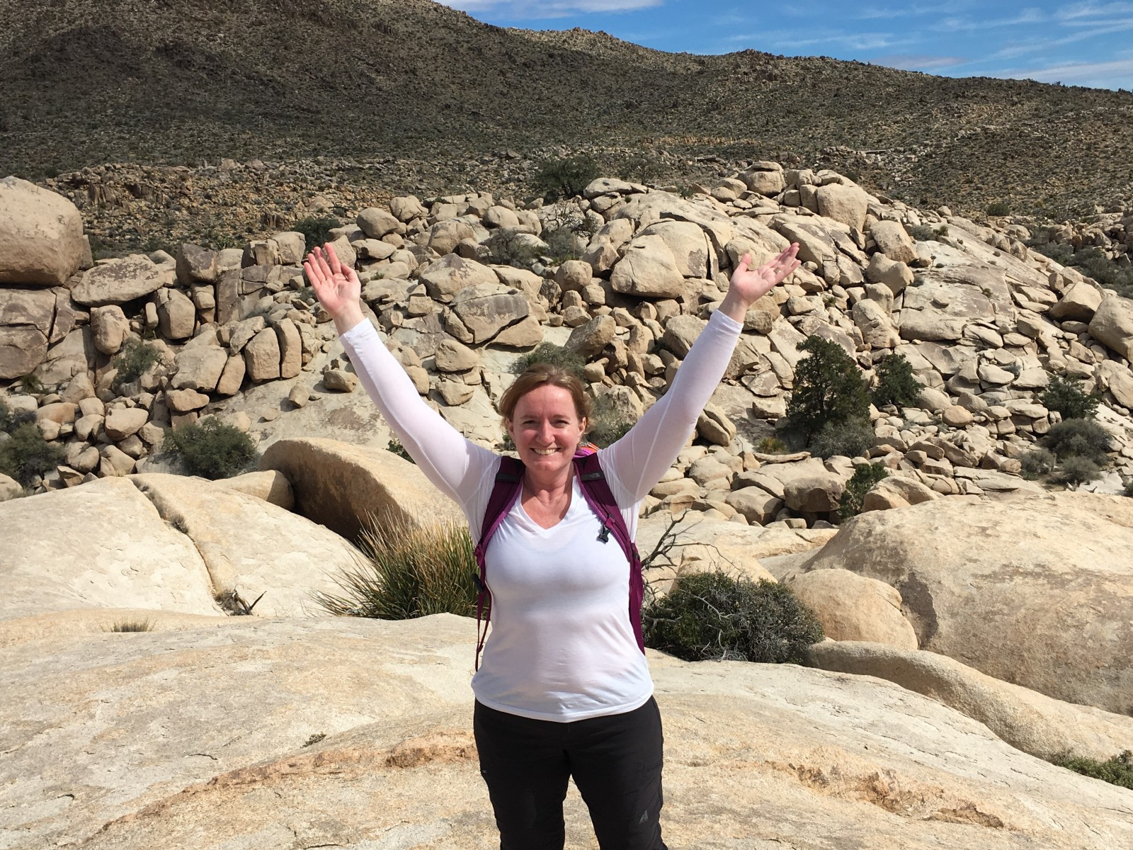 Facing my fear of heights to scramble up a 450 feet high rock pile in Joshua Tree leaves me feeling grateful for the whole world.