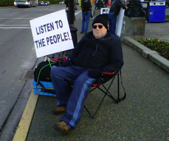 A picture I took of a protestor (with his permission) who set up camp outside the B.C. legislature week after week to protest tax changes.