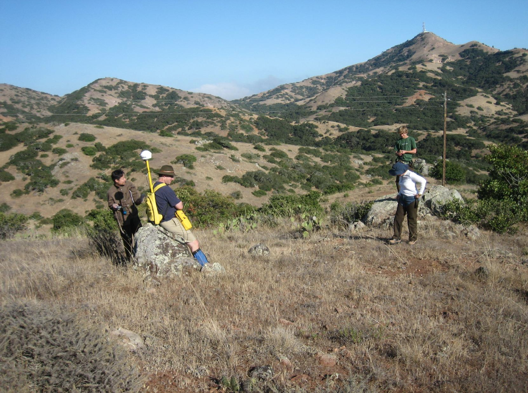 A volunteer survey team determines the boundary and type of an archaeological site found during the survey conducted to locate the sitesfrom which site signatures were developed.