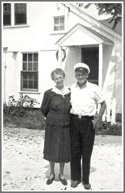 Cap Allen and his wife Lida, in front of the clam house.