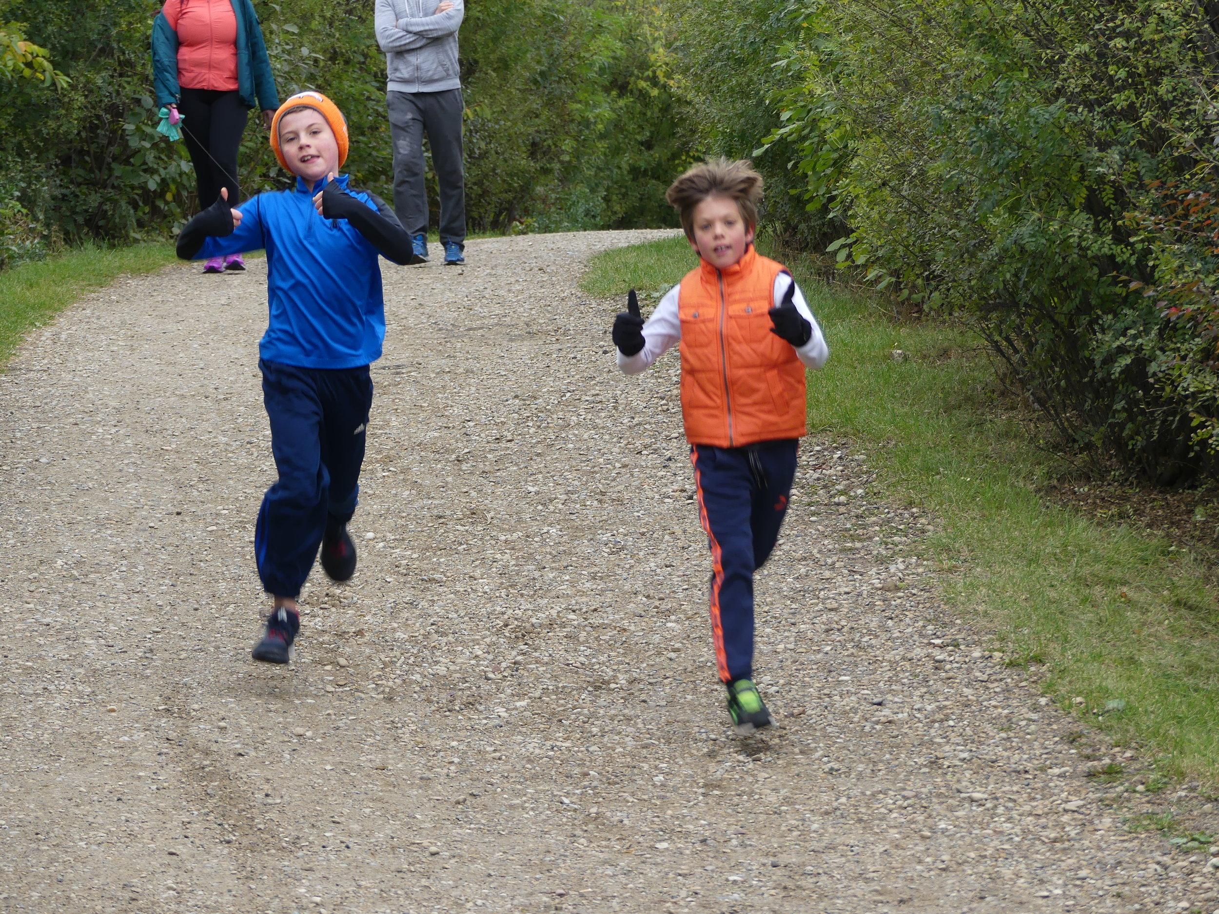 Logan and Joseph running for their Grandpa.