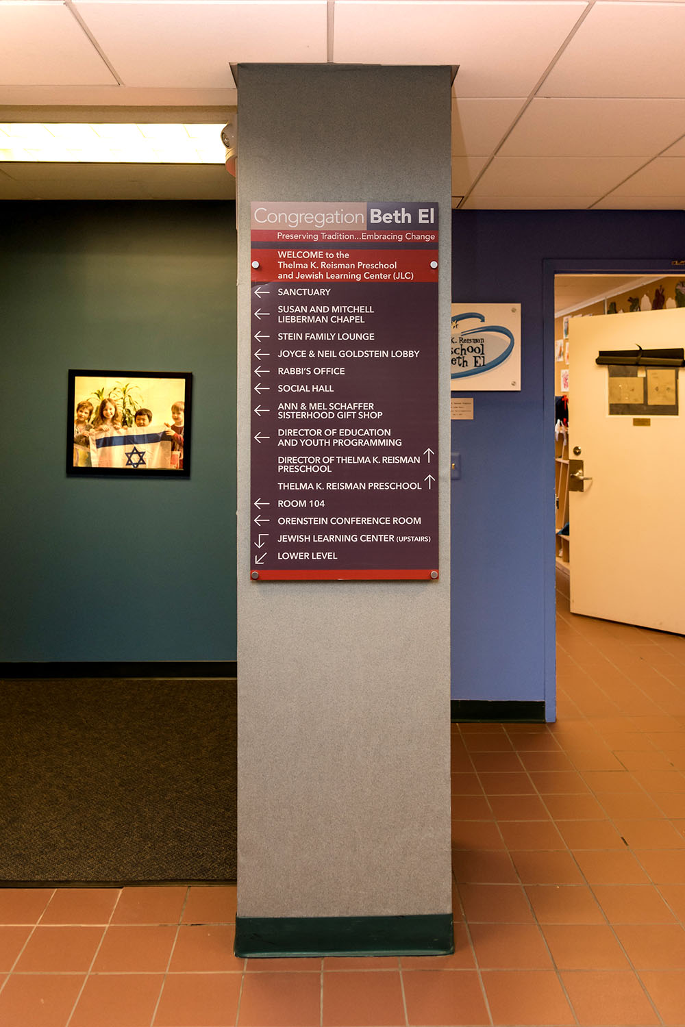Way-finding signs in administrative area; preschool sign in background