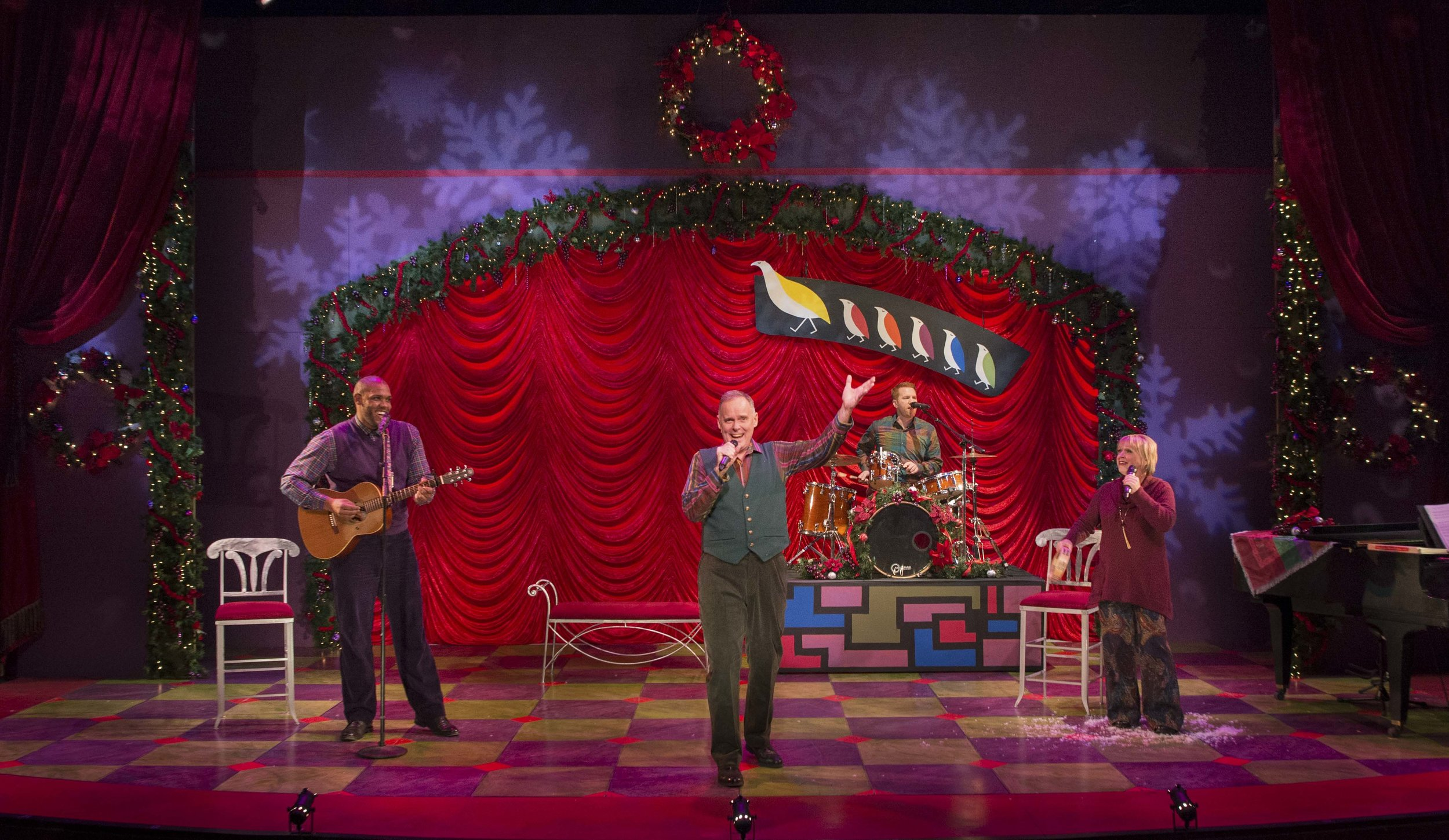 """Tod Petersen (center) leads a band of carolers through a Partridge Family-esque tune in his largely one-man show, Theater Latté Da's """"A Christmas Carole Petersen."""" Photos by Allen Weeks"""