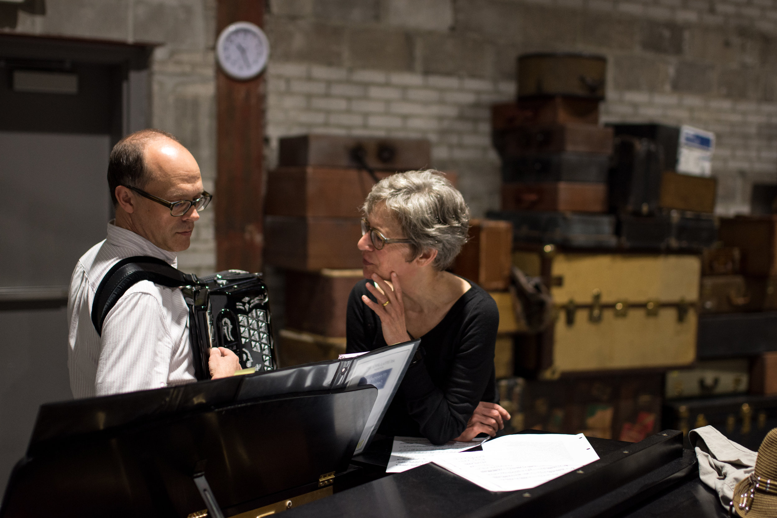 """Sally Wingert with musical director Dan Chouinard rehearsing """"Underneath the Lintel."""" Photo by Sally Wingert stars in the one-person play """"Underneath the Lintel,"""" showing at Theater Latté Da, May 30-July 1,featuring new music by Frank London. Photo by Emilee Elofson."""