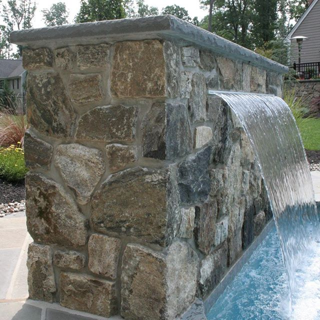 Add a water feature to take your pool to the next level this summer 💦 ⠀⠀⠀⠀⠀⠀⠀⠀⠀ #masonry #stonework #johncortesemason #cortesemasons #cortesemasonry #northjersey #newjersey #custom #handcrafted #design #trending #smallbusiness #smallbiz #experience #stone #stonework #home #backyardgoals #qualitystonework #homeimprovement #pools #poolscaping #waterfall #custompool
