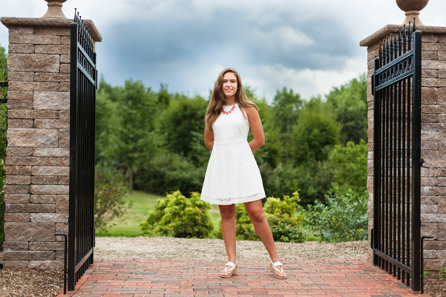 Erin Wood Photography Central CT senior photographer senior girl with stormy skies