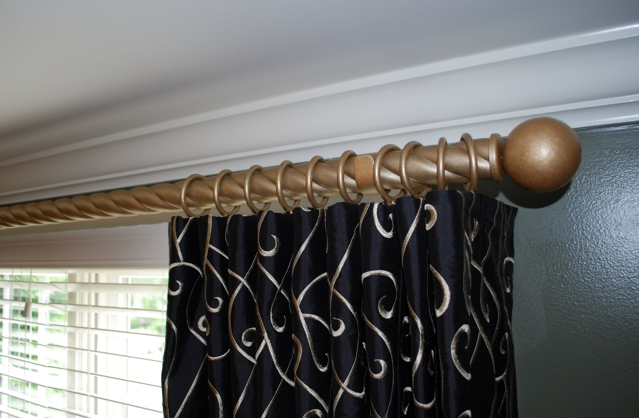 Drapery with wave header and wrought iron hardware